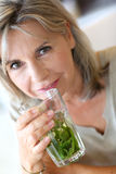 Woman drinking herbal infusion Royalty Free Stock Images