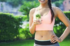 Woman drinking herbal tisane after fitness running workout on su Stock Images