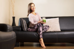 Woman drinking a homemade green detox juice Royalty Free Stock Photos
