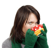 Woman drinking a hot beverage Stock Images