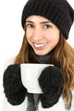 Woman drinking hot beverage in winter Stock Image