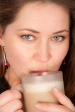 Woman drinking a hot coffee Stock Photos