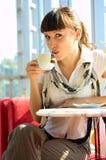 Woman drinking hot coffee stock photos