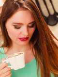 Woman drinking hot coffee beverage. Caffeine. Royalty Free Stock Image