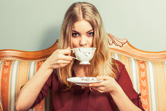 Woman drinking hot coffee beverage. Caffeine. Royalty Free Stock Photography