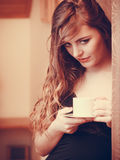 Woman drinking hot coffee beverage at home Royalty Free Stock Photos