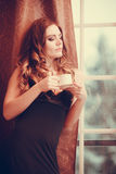 Woman drinking hot coffee beverage at home Royalty Free Stock Photo