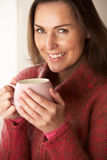 Woman drinking hot drink Royalty Free Stock Photography