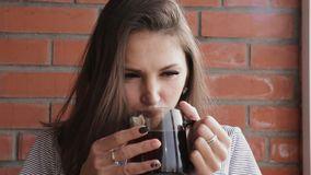 Woman drinking a Hot Drink at Balcony Apartment.  stock footage