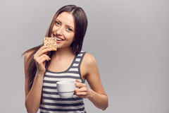 Woman drinking hot drink from disposable paper cup Stock Photos