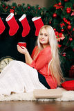 Woman drinking a hot drink Royalty Free Stock Image