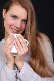Woman drinking a hot drink Royalty Free Stock Images
