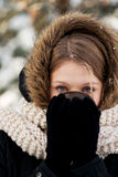 Woman drinking hot drink outdoors. Teenager drinking hot drink in the winter outdoors Royalty Free Stock Photo