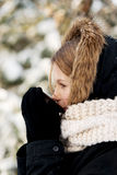 Woman drinking hot drink outdoors. Teenager drinking hot drink in the winter outdoors Stock Image