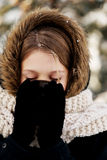 Woman drinking hot drink outdoors. Teenager drinking hot drink in the winter outdoors Royalty Free Stock Image