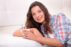 Woman drinking hot drink Stock Photo