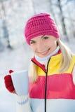 Woman drinking hot tea. Beautiful blond woman drinking hot tea outdoors Royalty Free Stock Photos