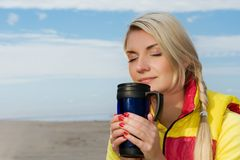 Woman drinking hot tea Stock Photos