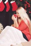 Woman drinking a hot tea Stock Photo