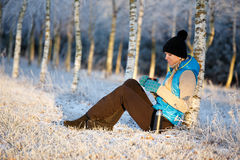 Woman drinking hot tea in winter Royalty Free Stock Photography
