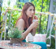 Woman drinking ice coffee Stock Images