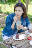 Woman drinking ice greentea and cake Royalty Free Stock Image