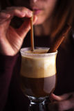 Woman drinking Irish coffee with spices Royalty Free Stock Image