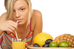 Woman drinking juice Stock Images