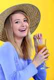 Woman drinking juice. Young smiling woman drinking juice Royalty Free Stock Photography
