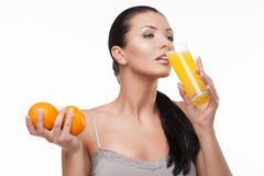 Woman drinking juice Stock Photography
