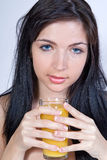 Woman drinking juice Stock Image