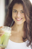 Woman drinking juice Stock Photo