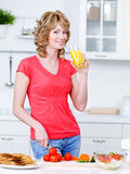 Woman drinking juice and cooking Stock Photos