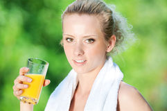 Woman drinking juice after exercise Stock Image