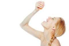 Woman drinking juice  from an orange fruit Royalty Free Stock Photography