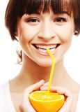 Woman drinking juice with straw. Beautiful woman drinking juice with straw Stock Images