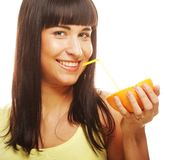 Woman drinking juice with straw. Beautiful woman drinking juice with straw Stock Photos