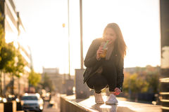 Woman drinking juice with straw in street Royalty Free Stock Photo