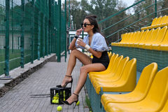 Woman is drinking a latte from the tube Royalty Free Stock Photography