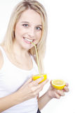 Woman drinking a lemon with straw Stock Photos