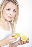 Woman drinking a lemon with straw Stock Photography