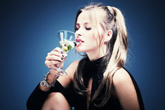 Woman drinking martini Royalty Free Stock Photo