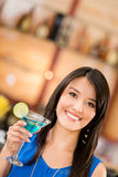 Woman drinking a martini Stock Photography