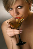 Woman drinking martini cocktail. Close-up of beautiful woman with exciting red lips drinking martini cocktail Royalty Free Stock Image