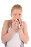 Woman is drinking from metal cup Royalty Free Stock Photos