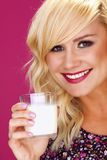 Woman drinking milk. Royalty Free Stock Photos