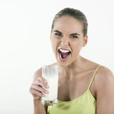 Woman drinking milk Royalty Free Stock Photography