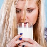 Woman drinking milk from glass. Healthy drinks, good nutrition, perfect breakfast concept. Woman drinking milk from glass Stock Photography