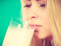 Woman drinking milk from glass. Healthy drinks, good nutrition, perfect breakfast concept. Woman drinking milk from glass Royalty Free Stock Photos