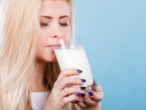 Woman drinking milk from glass Stock Photography